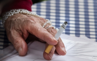 Elderly woman smoking in a nursing home